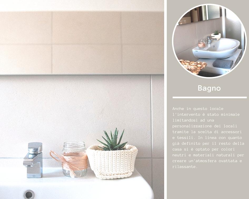 Dettaglio lavabo bagno decorato con vasetti e piante grasse
