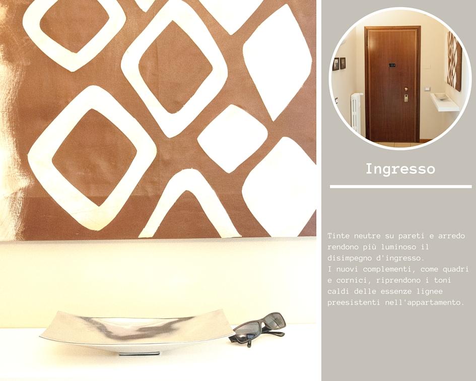 Ingresso appartamento con mensola bianca e grande quadro tribale marrone e bianco