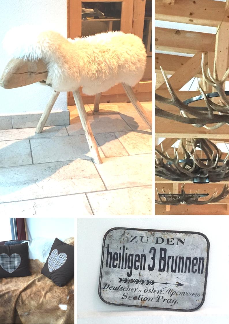 Familienhotel Bellavista Trafoi, hall ingresso, lampadari con corna di cervo, targa in latta antica di sentiero di montagna