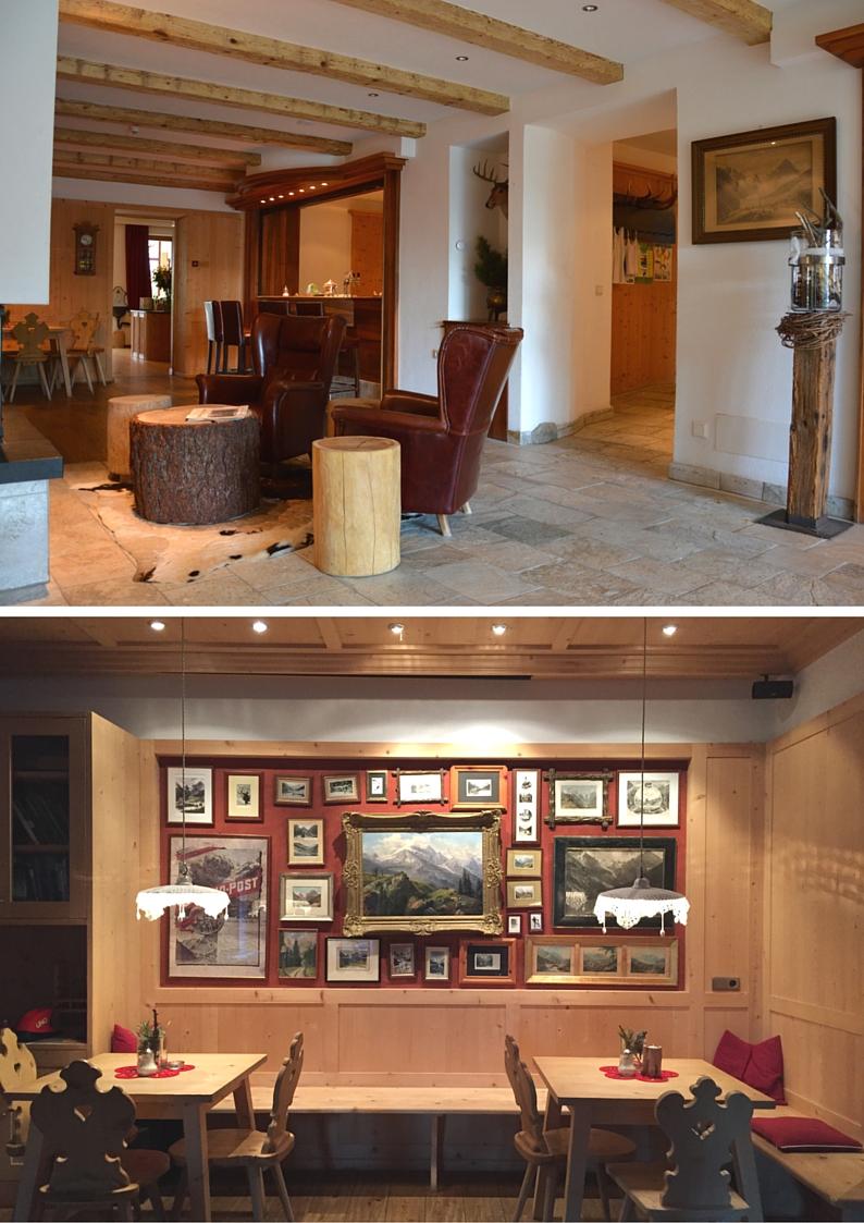Familienhotel Bellavista Trafoi, salottino in pelle, tavolini con tronchi albero, parete rossa con boiserie in legno e fotografie